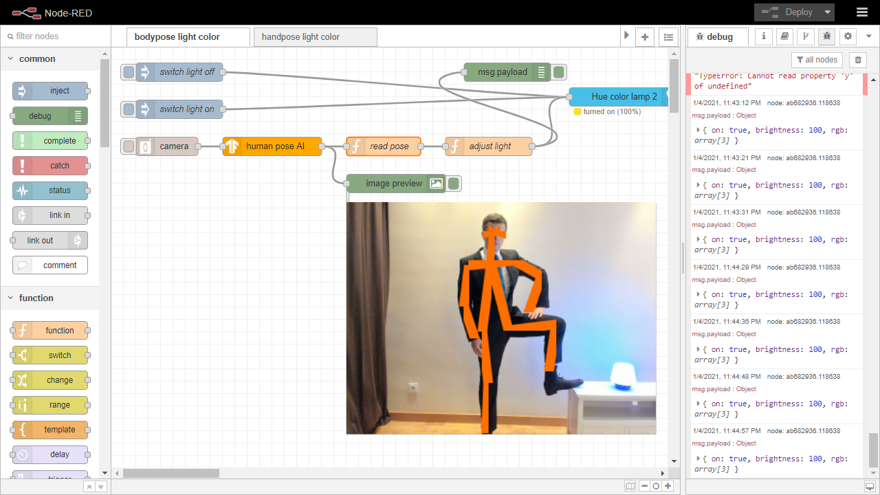 screenshot of node-red with a webcam image of a human pose, analyzed by AI to change the color of a light depending on limb's positions